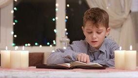 Kid reading book out loud. stock video footage