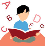 Kid reading a book, white background with alphabet. S Stock Photo