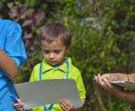 Kid receiving certificate Royalty Free Stock Photo