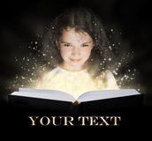 Kid reading the magic book Stock Image