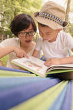 Kid reading with mom together Stock Images
