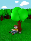 Kid reading under tree Stock Photography
