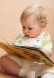 Kid reads book Stock Photo