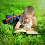 Kid reads a Book Royalty Free Stock Images