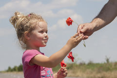 Kid receiving flowers Royalty Free Stock Images