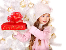 Kid with red Christmas gift box. Stock Images