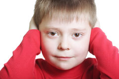 Kid in red closing ears stock image