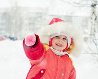 The kid in red jacket winter. Stock Image