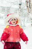 The kid in red jacket winter. Stock Photos