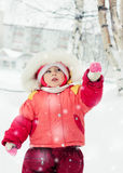 The kid in red jacket winter. Royalty Free Stock Image