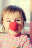 Kid with red nose. Clown fooling around Royalty Free Stock Image