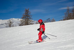 Child skiing in a sunny day Stock Images