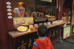 Kid at refreshment kiosk for food