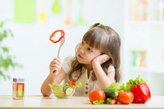 Kid refusing to eat his dinner. Pretty kid girl refusing to eat her dinner healthy vegetables Stock Photography