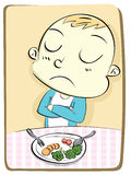 Kid refusing to eat vegetable. Stock Photos