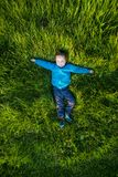 Kid relax on the grass stock photo