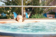 Kid relaxing in jacuzzi royalty free stock photography