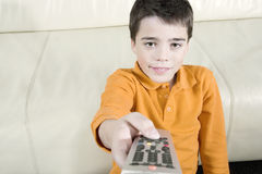 Kid with Remote Control Stock Photography