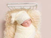 Kid resting covered with yellowish cover sheet Stock Photo
