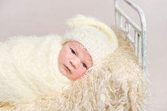 Kid resting covered with yellowish cover sheet Royalty Free Stock Images
