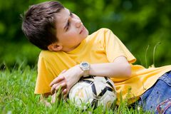 Kid resting in meadow Stock Images
