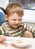 Kid and rice porridge royalty free stock images