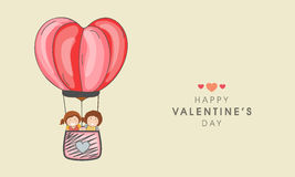 Kid ride hot air balloon for Valentines Day celebration. Royalty Free Stock Image