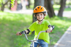 Kid rides a bicycle Royalty Free Stock Images