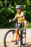 Kid riding bicycle Stock Photography