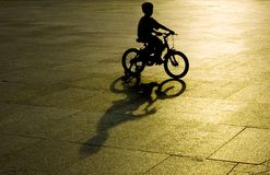 Kid riding bicycle stock images
