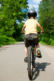 Kid riding bicycle Royalty Free Stock Photo