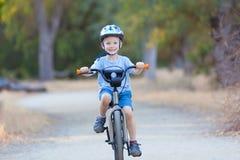 Kid riding bicycle Royalty Free Stock Photos