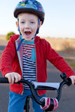 Kid riding bike Royalty Free Stock Photo