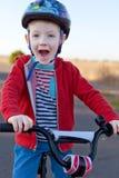 Kid riding bike Royalty Free Stock Photo