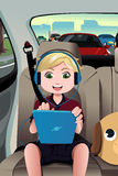 Kid riding a car using a tablet Royalty Free Stock Photography