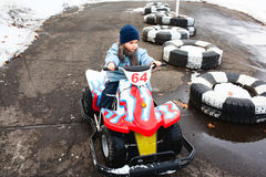 Kid riding toy car Stock Images