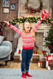 Kid rising arms up with gift box. Happy kid rising arms up with Christmas gift box stock images