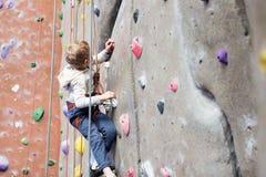 Kid rock climbing Royalty Free Stock Images