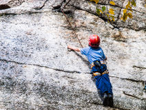 Kid Rock Climbing Royalty Free Stock Photos