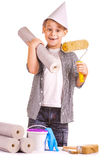 Kid with a roll of wallpaper and brush. isolated Royalty Free Stock Images