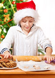Kid rolling dough Stock Photo