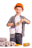 Kid with a rolls of wallpaper and brush. isolated Royalty Free Stock Image
