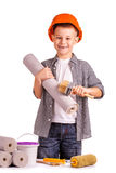 Kid with a rolls of wallpaper and brush. isolated Stock Image