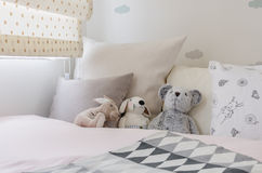 Kid room with dolls and pillows on bed Stock Photos