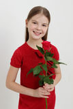 Kid and rose Stock Image