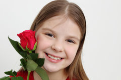 Kid and rose Royalty Free Stock Photos