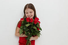 Kid and roses Stock Image