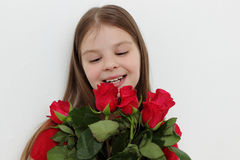 Kid and roses Royalty Free Stock Images