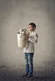 Kid with rubbish bin Royalty Free Stock Image