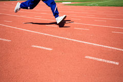 Kid runing on track in the Stadium.  Royalty Free Stock Image